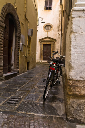 backstreet: Backstreet and a bicycle in Lucca, Tuscany, Italy
