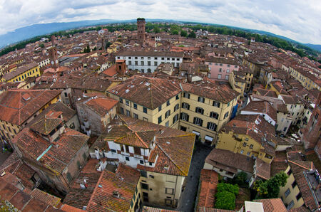 Fisheye view cityscape of Lucca with Guinigi tower in front, Tuscany, Italy Editorial