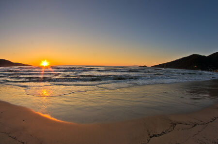 Sunrise and waves at the golden beach, Thassos island in Greece