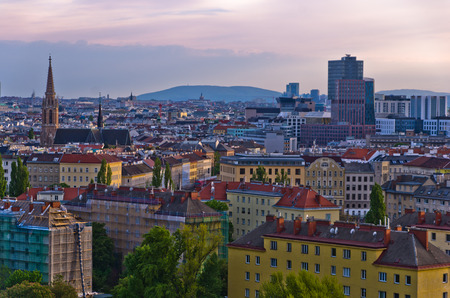 Vienna cityscape at sunset, mix of different ages, styles and colors, Austria photo