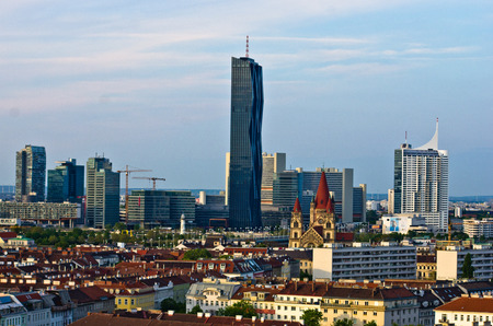 Vienna skyline at sunset, contrast between modern skycrapers and old style buildings, Austria Stock Photo