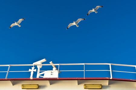 thassos: Seagulls in low flight over the ferry near Thassos island in Greece Stock Photo