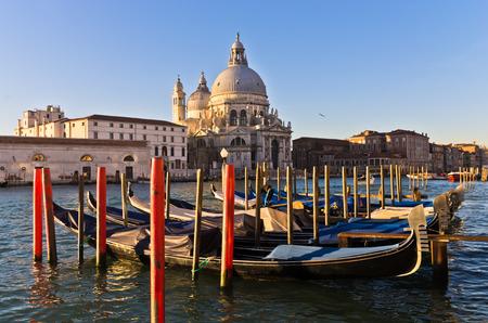 Morning in Venice, gondolas, Grand Canal and Santa Maria church, Italy photo