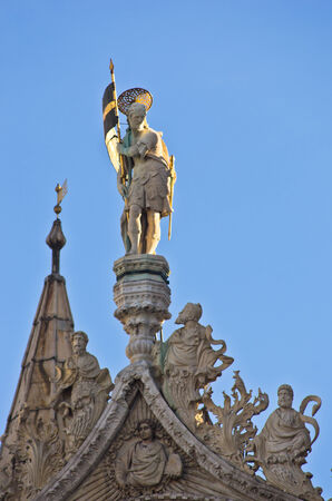 saint mark square: Artistic details at the top of San Marco basilica at piazza San Marco in Venice, Italy