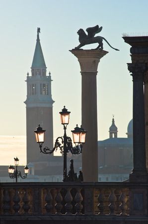 San Marco columns with winged lion at east side of piazza San Marco in Venice, San Giorgio Maggiore church is visible at the other side of Grand Canal, Italy photo