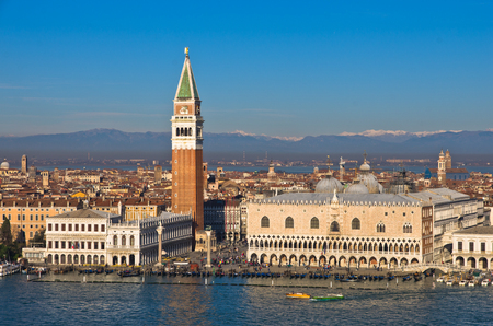 Campanila bell tower at piazza San Marco from the other side of a channel, Venice, Italy photo