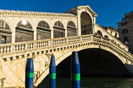 rialto bridge: Rialto bridge at Grand canal in Venice at sunny morning, Italy Stock Photo