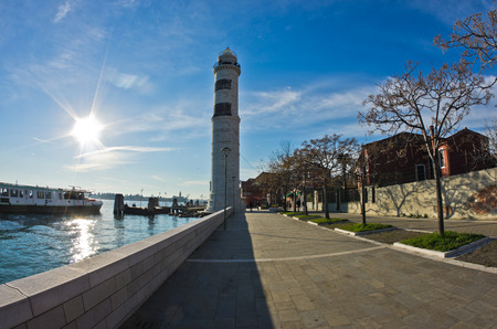 Murano: Lighthouse and pier at Murano island in Venice, Italy