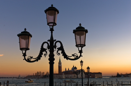 Lantern at sunset in Venice, San Giorgio Maggiore in background, Italy photo