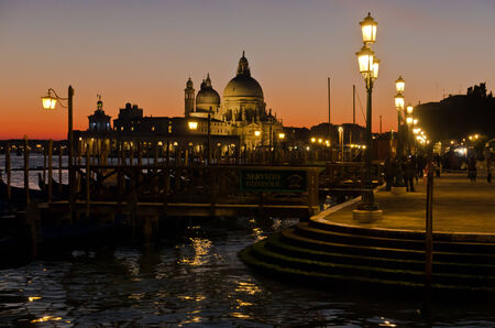 Lantern at twilight in Venice, Santa Maria della Salute in background, Italy photo