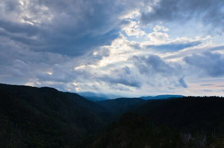 Landscape of Divcibare mountain with dark clouds at Sunset, west Serbia