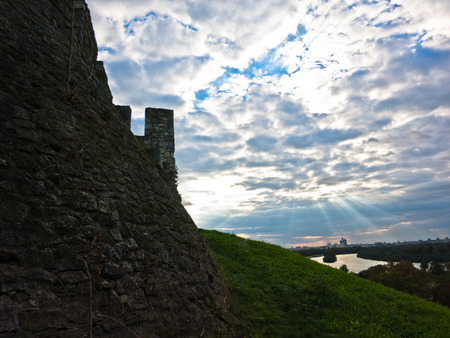 confluence: View from Kalemegdan fortress to confluence of Danube and Sava river under dramatic clouds, Belgrade, Serbia