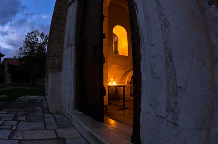 the world heritage: Church inside 12.century Studenica monastery during evening prayer, UNESCO world heritage site in Serbia