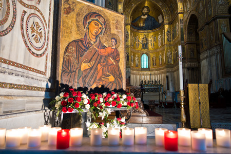 pantocrator: Inside Monreale cathedral or Duomo di Monreale virgin Mary icon and Christ Pantocrator fresco in background Sicily Italy