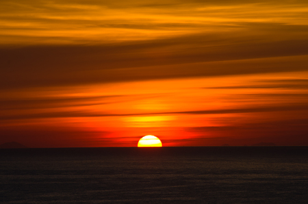 Sunrise over sea at Sicily Lipari islands on a horizon Italy photo