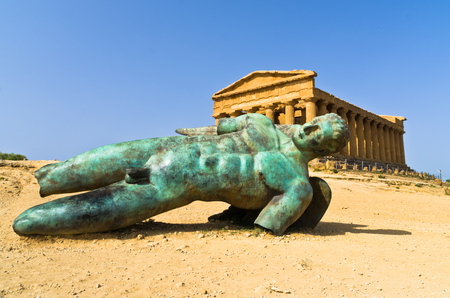 concordia: Icarus statue in front of Temple of Concordia at Agrigento Valley of the Temple Sicily Italy