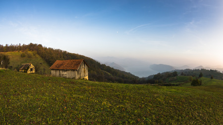 hillsides: Autumn sunset at hillsides and meadow with mist over Danube river in Serbia