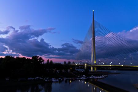 cable bridge: Cable bridge at twilight over Sava river near Ada island, Belgrade, Serbia Stock Photo