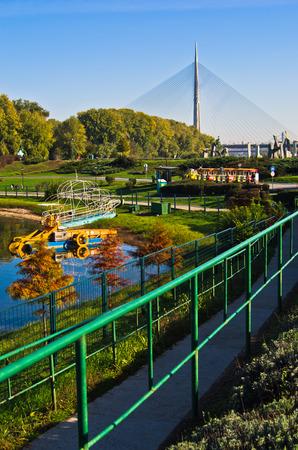 cable bridge: Ada lake at sunny morning, tourist trane and a cable bridge in a background, Belgrade, Serbia