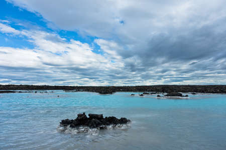 therapy geothermal: Blue lagoon geothermal spa near Grindavik, Iceland. Blue lagoon geothermal spa is located in a lava field in Grindavk on the Reykjanes Peninsula, southwestern Iceland.