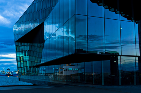 concert hall: Harpa concert hall and opera house in Reykjavik harbor at blue hour, Iceland