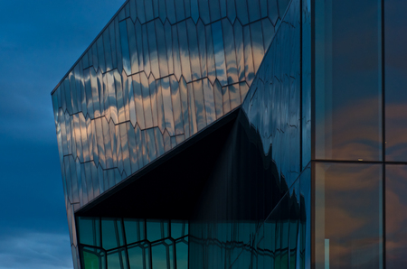 morning blue hour: Harpa concert hall and opera house in Reykjavik harbor at sunrise, Iceland