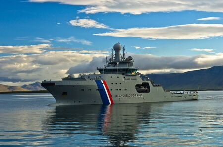 guard ship: Coast guard ship entering Reykjavik harbor after early morning patrol, Iceland