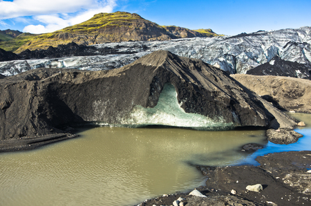 glacial: Vatnajokull glacier covered with volcanic ash is melting to glacial river, south Iceland Stock Photo