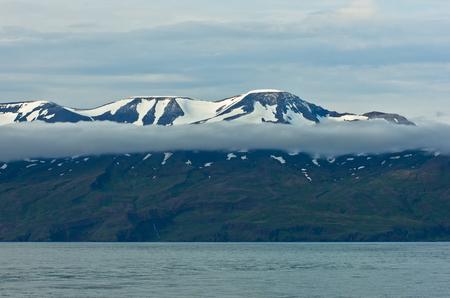 views of the mountains: North coast of Iceland on the shores of Skjalfandi Shaky bay above Mid-Atlantic Ridge where american and european tectonic plates merge Stock Photo