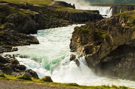 glacial: Glacial river with Godafoss waterfall in background, north Iceland Stock Photo