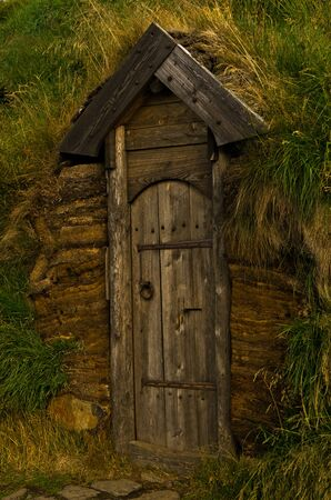 reconstructed: Old wooden door, a detail from reconstructed house of famous viking Erik the Red at Eirikstadir in northwest Iceland Stock Photo