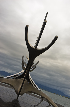 voyager: Solfar, Sun Voyager is a huge stainless-steel sculpture of a viking boat by Jon Gunnar Arnason, set on granite beside the sea, Reykjavik, Iceland