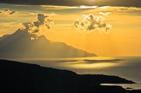 sulight: Greek coast of aegean sea at sunrise near holy mountain Athos, Chalkidiki, Greece Stock Photo
