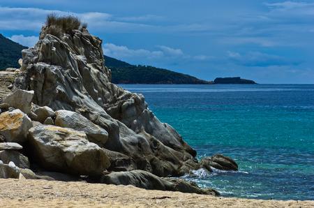 sithonia: Sea rocks on a sandy beach at early morning, west coast of peninsula Sithonia, Chalkidiki, Greece Stock Photo