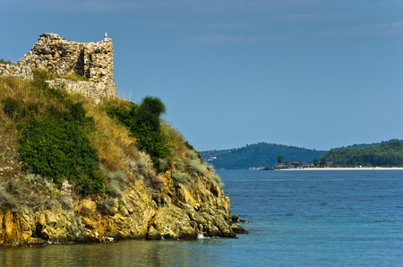 sithonia: Ruins of old roman fortress with sandy beach in background, Toroni, Sithonia, Greece