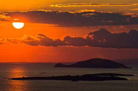 sithonia: Sunset at sea, with small greek islands in background, Sithonia, Greece