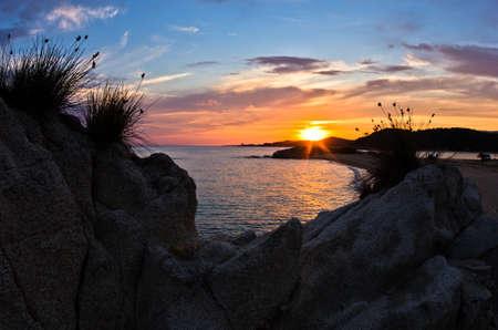 sithonia: Sea rocks with mediterranean dry grass at sunset, west coast of peninsula Sithonia, Chalkidiki, Greece