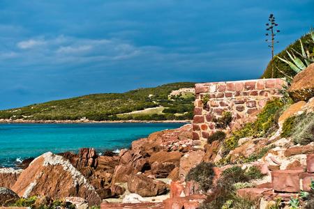 pietro: Red rocks and turquoise water at beach in San Pietro island, Sardinia, Italy Stock Photo
