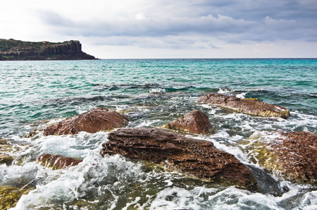 pietro: Sea rocks and waves at beach in San Pietro island, Sardinia, Italy Stock Photo