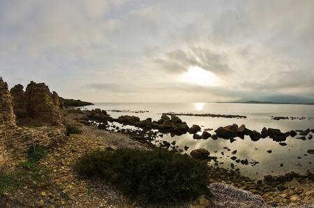 archeological site: Sunset on a beach at Nora archeological site, near city of Pula, island of Sardinia, Italy