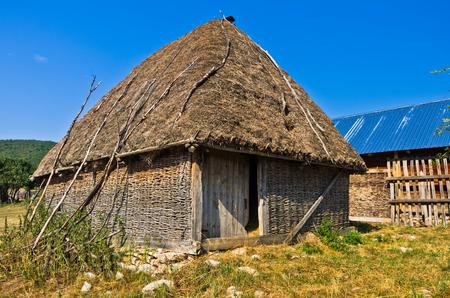 serbia landscape: Rural wooden lodge at Pe�ter plateau landscape in southwest Serbia