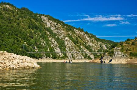 serbia landscape: Landscape with pedestrian bridge at river Uvac gorge, southwest Serbia