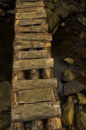 Narrow and ruined small wooden bridge at Black river gorge, Serbia