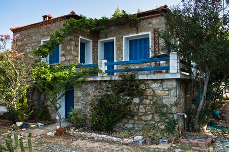 sithonia: Greek house traditionaly made of stone with blue and white colored windows in Sithonia, Greece