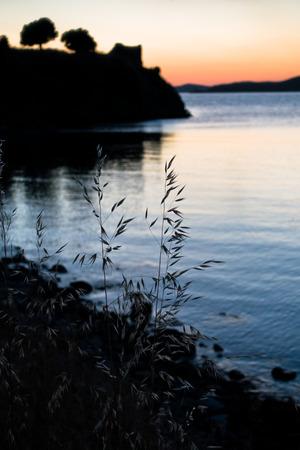 sithonia: Sunset at Toroni bay near old roman fortress in Sithonia, Greece