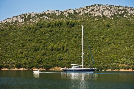 sithonia: Sailboat anchored at Porto Koufo harbor at morning, west coast of Sithonia, Greece
