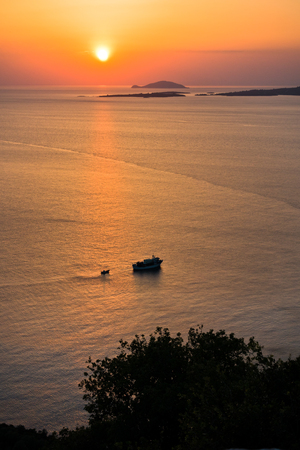 greek islands: Sunset at sea, with small greek islands in background, Sithonia, Greece