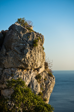 sithonia: Rocky cliff above Aegean sea at sunset in Sithonia, Greece