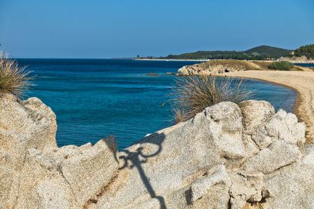 sithonia: Sea rocks at sandy beach, early morning at west coast of peninsula Sithonia, Chalkidiki, Greece Stock Photo