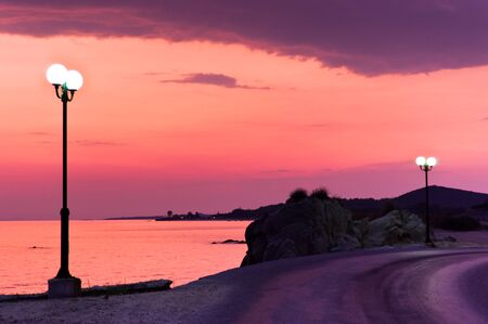 sithonia: Streetlights along the coastal road at blue hour in Sithonia, Greece Stock Photo